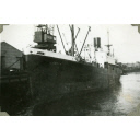 Black and White Photograph in album of ship 'Carlo' at dockside